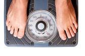 Waman feet on scale, diet watching — Stock Photo