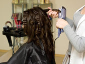 Getting haircut at the beauty salon — Stock Photo