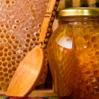 Jars of honey and honeycomb — Stock Photo #4511037
