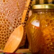 Jars of honey and honeycomb - Stock Photo