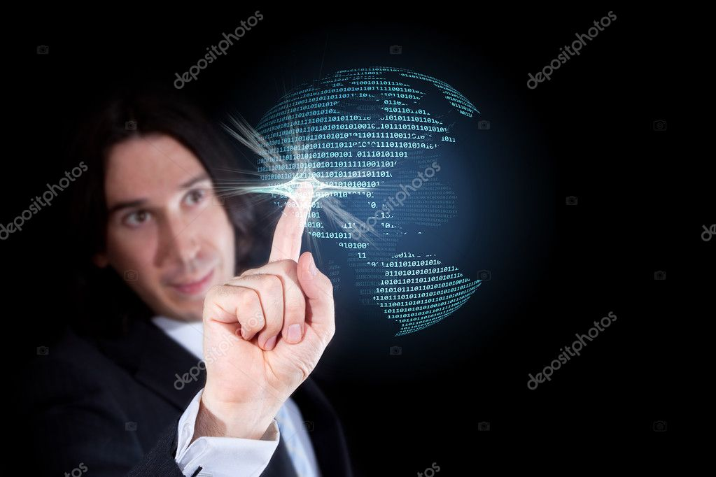 Businessman touching a world globe made of a binary code, isolated against a black background  Stock Photo #5117988