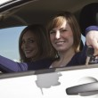 Two happy women in a car — Stock Photo #4194179