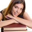 Woman with a stack of books — Stock Photo #4194286