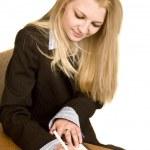 Woman balancing her check book — Stock Photo #4194375