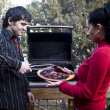 Couple having a barbeque — Stock Photo #4194454
