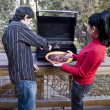 Couple having a barbeque — Stock Photo #4194456