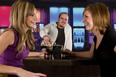Young women at the bar — Stock Photo