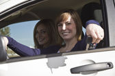 Two happy women in a car — Stock Photo