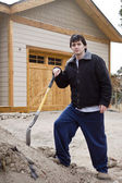 Worker in front of a new house — Stock Photo