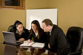 Professionals at a conference table — Stock Photo