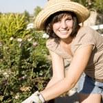 Woman in the yard gardening — Stock Photo #4202446