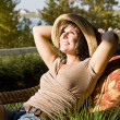 Woman sitting on a patio chair — Stock Photo #4202559