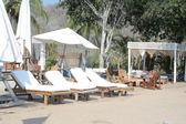 Beach lounge chairs — Stock Photo