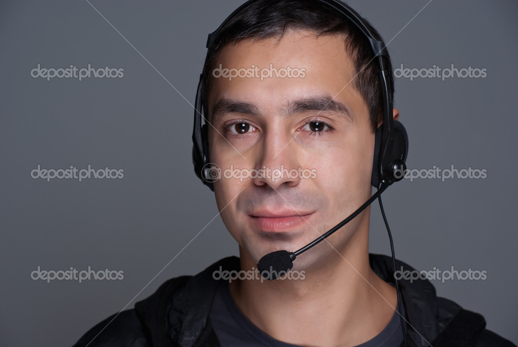 Male customer service representative. Isolated on grey background. — Stock Photo #4272546