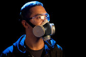 A man in a respirator and glasses — Stock Photo