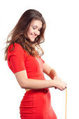 Beauty happy while measuring her waist — Stock Photo