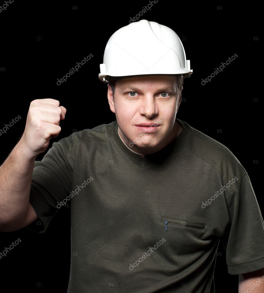 Malicious construction superintendent in a white helmet  Isolated on black background.  Stock Photo #5030933