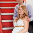 Pregnant couple on a stairway — Stock Photo #5214419