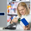 Attractive pharmacist - Stock Photo