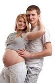 Young man embracing his pregnant wife. — Foto de Stock