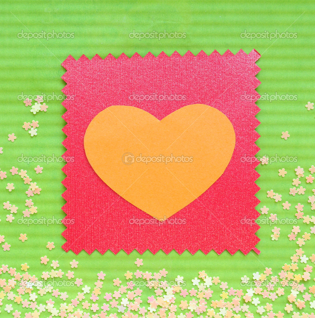 Valentine paper card gift with love heart on greem background decorated with little flowers.   #4253922