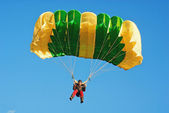 The guy parachutist in red overalls — Stock Photo