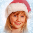 Young girl in santa`s hat — Stock Photo