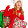 Young girl in santa cloth with gift bags — Stock Photo #4273392