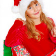 Stock Photo: Young girl in santa cloth with gift bags