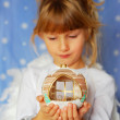 Angel girl holding christmas ball in hand — Stock Photo #4273495