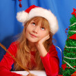 Stock Photo: Girl writing letter to santa