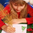 Girl writing a letter to santa — Stock Photo #4273576