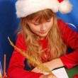Girl writing a letter to santa — Stock Photo #4273585
