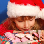 Girl and christmas gingerbreads — Stock Photo #4273602