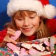 Girl and christmas gingerbreads — Stock Photo