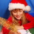 Stock Photo: Girl writing a letter to santa