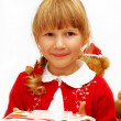 Royalty-Free Stock Photo: Little girl with christmas eve wafer on plate