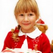 Little girl with christmas eve wafer on plate — Stock Photo #4273943