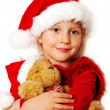 Little girl in santa cloth with teddy bear — Stock Photo