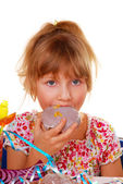 Little girl on birthday party — Stock Photo