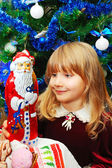 Little girl in christmas time — Stock Photo