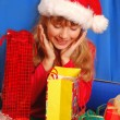 Girl and christmas gifts — Stock Photo