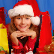Stock Photo: Girl and christmas gifts