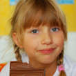 Little girl eating chocolate — Stock Photo #4319877