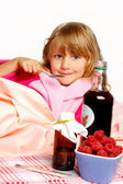 Sick little girl in bed — Stock Photo