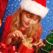 Girl and christmas gifts with snowy background — Stock Photo #4424110