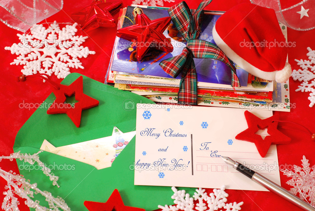 Writing traditional greeting cards for christmas to family or friends — Stock Photo #4424245