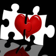 Puzzle with heart on black background — Stockfoto