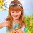 Young girl painting easter eggs — Stock Photo