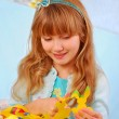 Young girl making easter decorations — Stock Photo